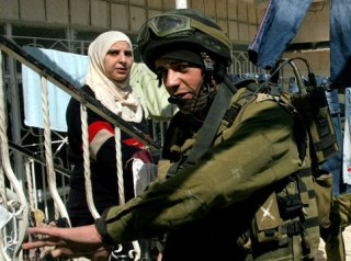Israeli soldier and a Palestinian woman
