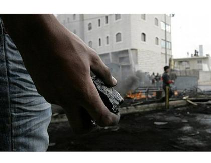 Palestinian holding stone