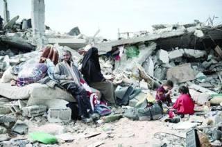 Gazan family sitting on ruins