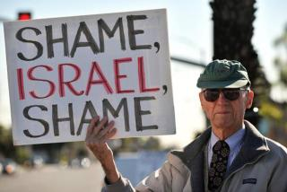 A man displays a placard during a demonstration in Anaheim, California.