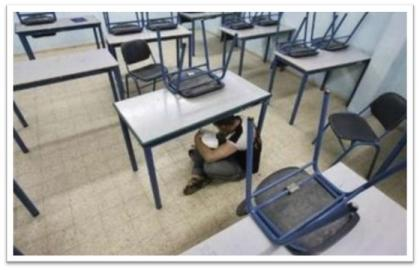 Sderot child hiding under a desk in school in wake of Qassam attacks