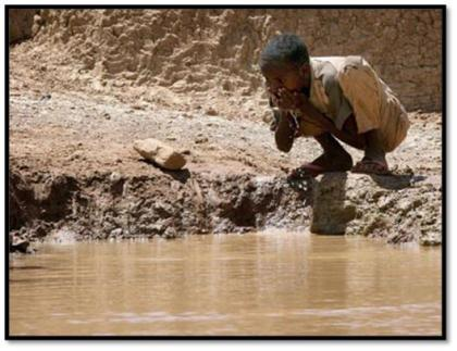 Somalian child drinking dirty water. Result of UN's war crimes in Somalia.