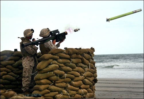 Staff Sgt. Tony L. Moore, Alpha Battery section leader with 2nd Low Altitude Air Defense Battalion, coaches a 2nd LAAD Marine as they fire off a Stinger missile Sept. 13 at Onslow Beach on Marine Corps Base Camp Lejeune.   Photo by: Cpl. Adam F. Testagrossa