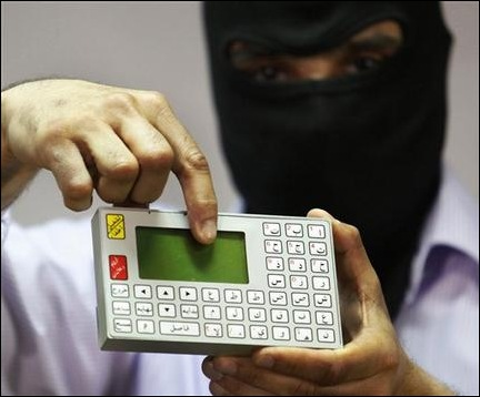 A masked man presents a futuristic calculator