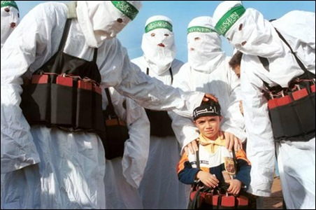HAMAS terrorists encourage Palestinian child during Gaza rally