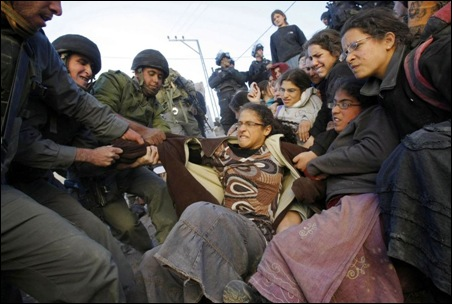 IDF soldiers evacuating Jewish settlers in Hebron