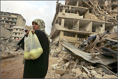 A woman amid rubble in Beirut - result of Nasrallah's recklessness vis-a-vis the Israelis