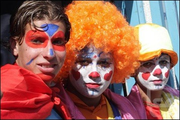 Gazans, dressed as clowns, celebrate on the streets (courtesy: Ma'an News Agency)