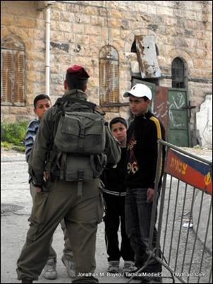 IDF solders talks to Palestinian children in Hebron